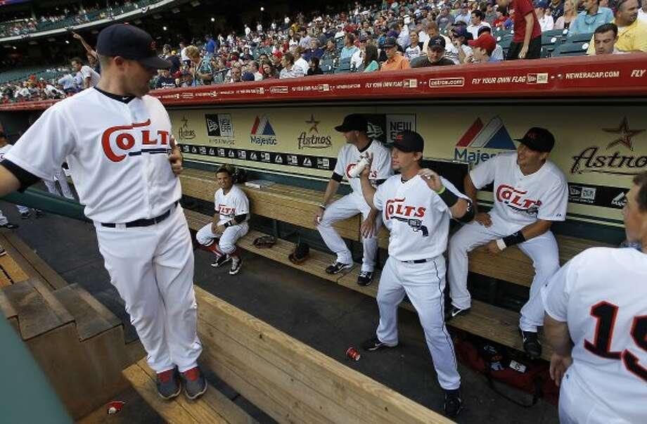 Astros third baseman Chris Johnson (23) fools around in the dugout. (Karen Warren / Chronicle)
