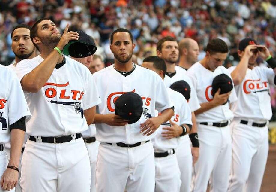 Astros left fielder J.D. Martinez points to the sky after the National Anthem. (Karen Warren / Chronicle)