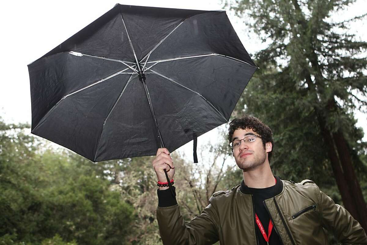 """Glee actor Darren Criss, takes a moment to pose for a portrait in the rain at the Young Actor's Theatre Camp at Hayward La Honda Music Camp in La Honda, Calif. on Wednesday, December 29, 2010. Criss who portrays the openly gay student Blaine, on Fox?•s musical drama series Glee, answered, """"No, I think the characters take on the actors characteristics."""" Kat Wade / Special to the Chronicle"""