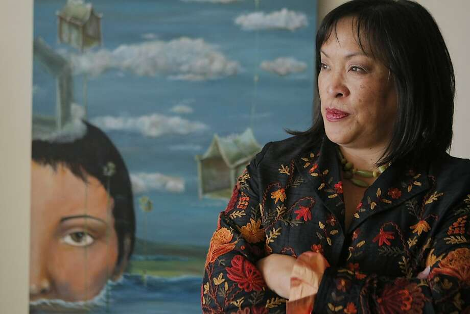 Surrealist painter Cynthia Tom, poses for a photograph in her San Francisco studio on Feb. 27, 2012. Photo: Erik Verduzco, The Chronicle