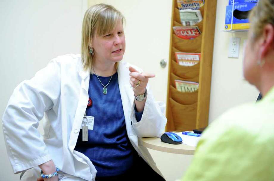 Holly Major, an adult nurse practitioner, talks with patient Kathleen Allen, of Ansonia, Tuesday, April 3, 2012 at Griffin Faculty Practice in Oxford, Conn. Photo: Autumn Driscoll / Connecticut Post