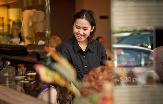 A server smiles at customers during dinner at Kacha Thai Bistro in Walnut Creek, Calif., on Friday April 7th, 2012. Photo: John Storey