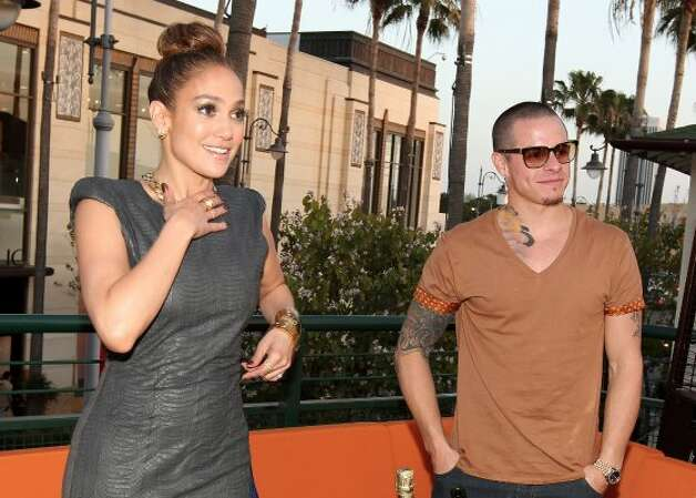 Jennifer Lopez's boyfriend Casper Smart doesn't need silly clothes, because it's pretty well covered in tattoos. They're at the opening of Planet Dailies & Mixology 101 on April 5 in Los Angeles. (Christopher Polk / Getty Images for Mixology 101)