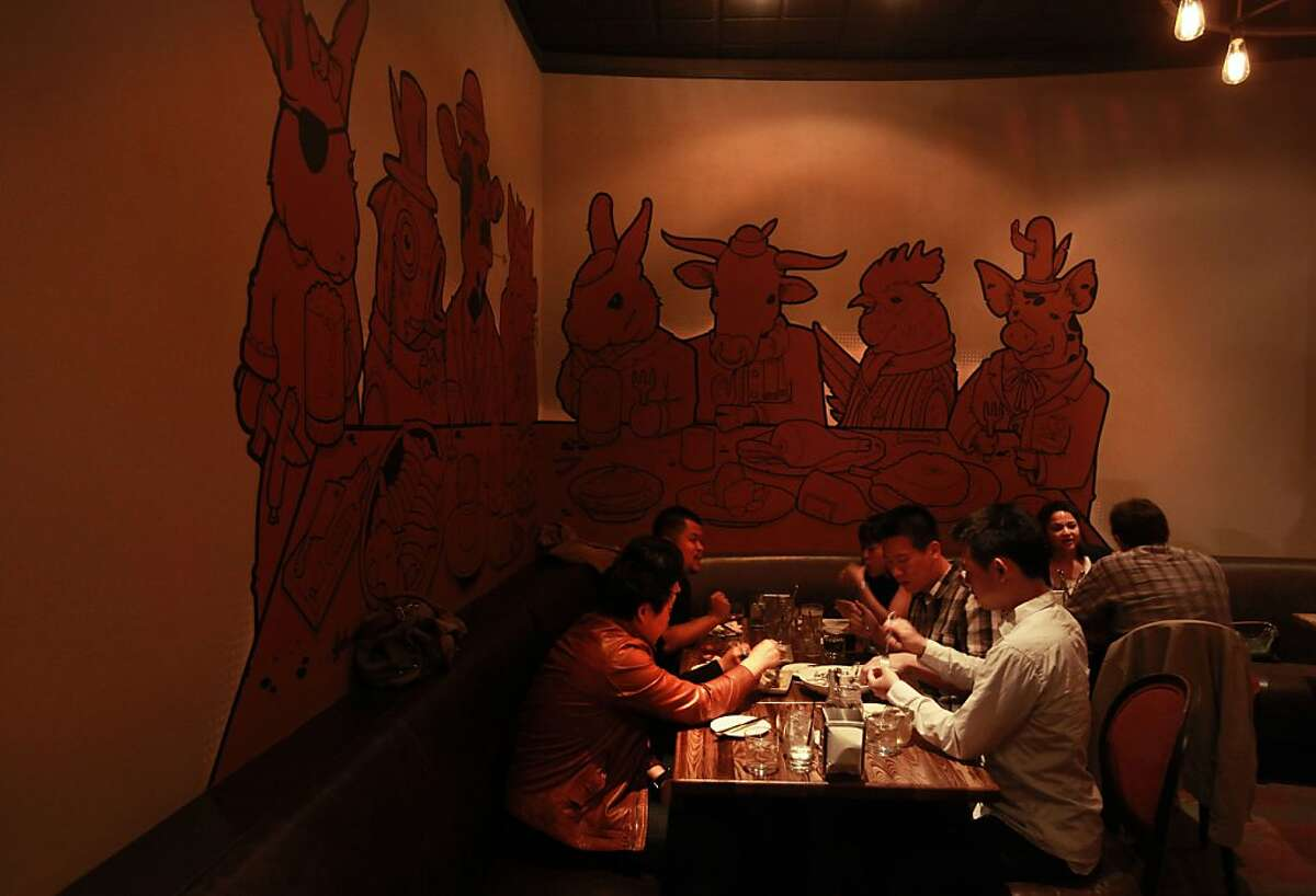 Ryan Maxey and Ian Begg are turning their Txoko in North Beach (pictured) into naked Lunch Pub & Grill, an extension of their Naked Lunch next door. The dark surroundings at Txoko come with a mural by Jeremy Fish of cartoon-like animals playing poker.