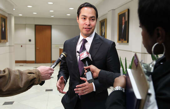 Mayor Julian Castro (center) fields questions from reporters regarding a proposed city bond election after the morning session of city council on Thursday, Jan. 12, 2012. If approved by council, the election will go to the voters on May 12 to approve the $596 million bond program for streets, parks, drainage, facilities and community initiatives. Kin Man Hu/kmhui@express-news.net Photo: KIN MAN HUI