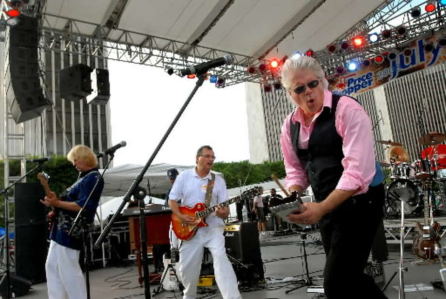 14. Sarge Blotto, also known as Greg Haymes, right, performs with the band Blotto during the Fourth of July celebration on Friday, July 4, 2008, at the Empire State Plaza in Albany, N.Y. The local band last performed at the Plaza in 1981, but this was their first July 4th appearance at the Plaza. (Cindy Schultz / Times Union archive)