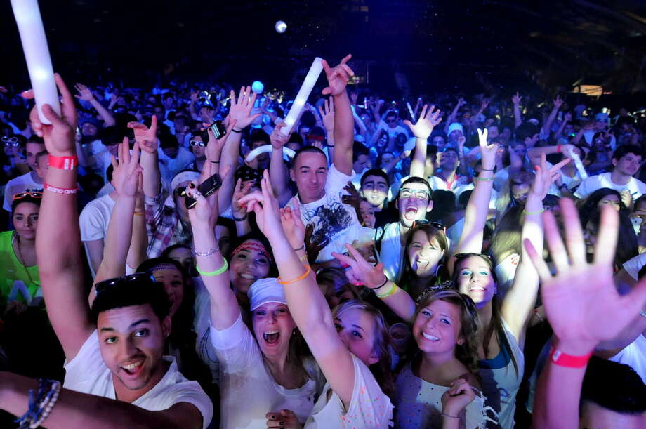 14. Electronic Music fans dance to the music during the Winter White Tour headlining David Guetta on Thursday, Feb. 2, 2012, at the Washington Avenue Armory in Albany, N.Y. (Cindy Schultz / Times Union archive)