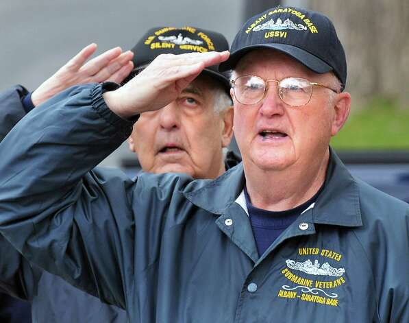 Albany-Saratoga Submarine Veterans Harry Terzian, left, of Colonie and Tom Glenn of Albany salute during a ceremony to toll the bell to honor the lost submarines and submarine sailors during a ceremony at Veteran?s Memorial Park in Ballston Spa Wednesday April 11, 2012. Korean War veterans, Terzian served aboard the USS Amberjack and Glenn aboard the USS Cutlass.  (John Carl D'Annibale / Times Union) Photo: John Carl D'Annibale / 00017162A