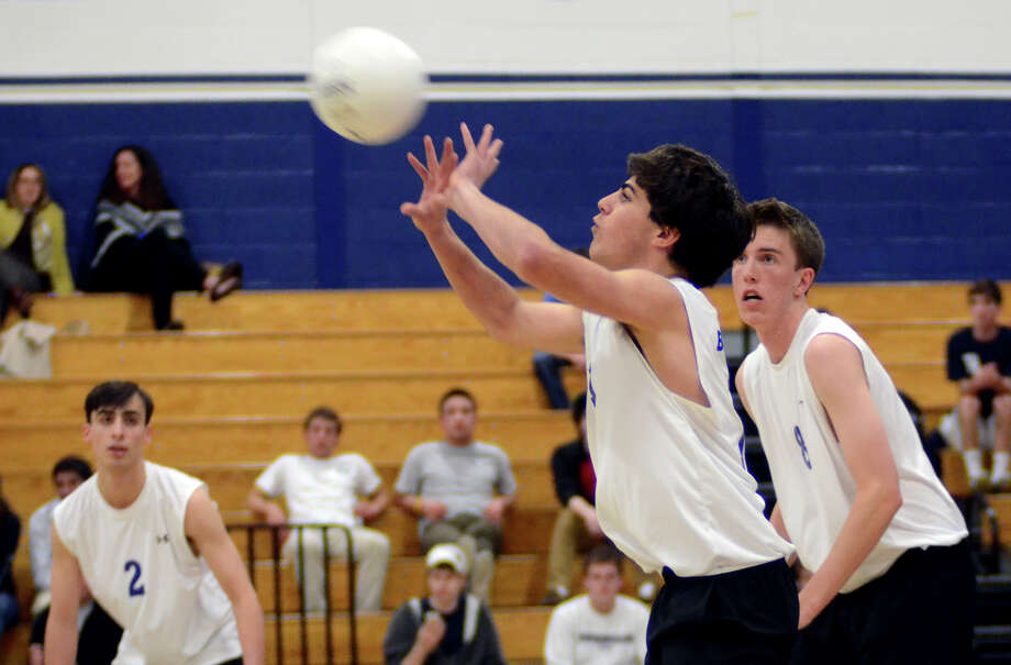 Darien's Ryan Stracuzzi (11) sends the ball over the net during the boys volleyball game against Staples at Staples High School on Wednesday, Apr. 11, 2012. Photo: Amy Mortensen / Connecticut Post Freelance