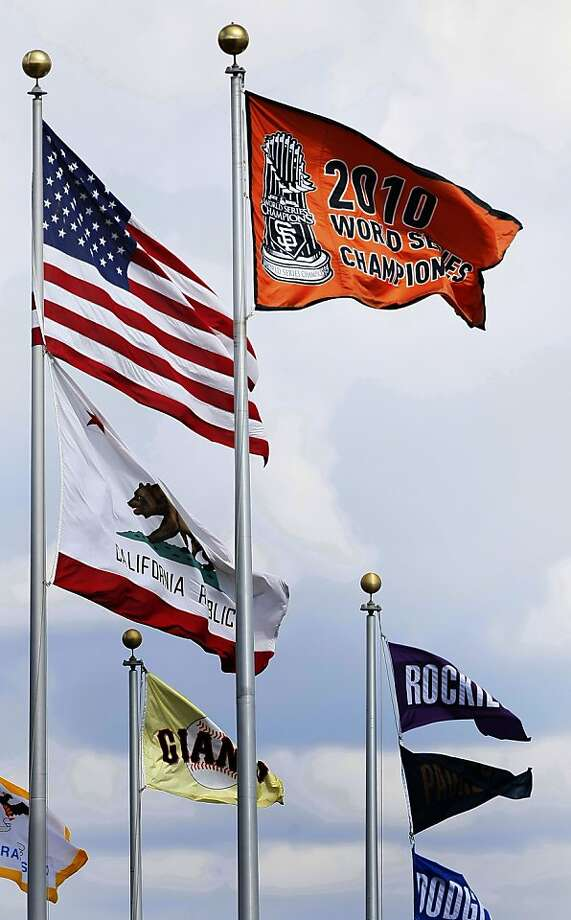 San Francisco Giants hoisted the World Series flag during opening ceremonies prior to their home opener with the St. Louis Cardinals on Friday. Photo: Lance Iversen, The Chronicle