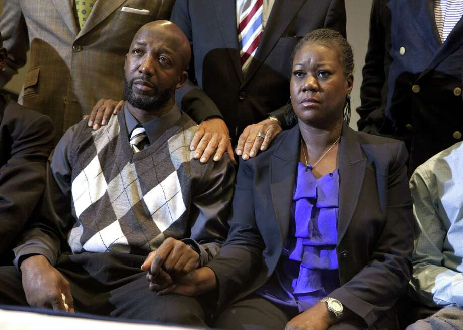 Sybrina Fulton and Tracy Martin, parents of Trayvon Martin, watch a televised news conference where charges against George Zimmerman were announced. Photo: Pool / 2012 Getty Images