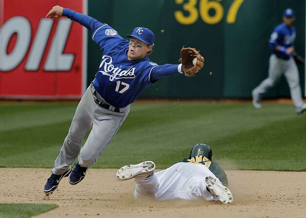 Oakland's Jonny Gomes steals second base in the sixth inning as the Royal's Chris Getz has to chase down wide throw , as the Oakland Athletics went on to beat the Kansas City Royals 5-4, in major league baseball action at the O.Co Coliseum on Wednesday April 11, 2012, in Oakland, Ca. Photo: Michael Macor, The Chronicle