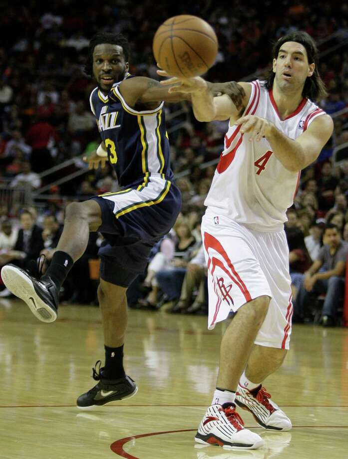 Houston Rockets' Luis Scola, right, passes the ball ahead of Utah Jazz's DeMarre Carroll, left, during the second quarter of NBA game at Toyota Center  Wednesday, April 11, 2012, in Houston. Photo: Melissa Phillip, Houston Chronicle / © 2012 Houston Chronicle