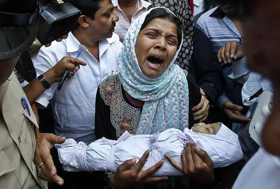 Reshma Bano wails as she holds the body of her three-month-old daughter Neha Afreen outside a hospital morgue in Bangalore, India, Wednesday, April 11, 2012. Afreen was admitted in the hospital on April 8 after allegedly being battered by her father for being born a girl. (AP Photo/Aijaz Rahi) Photo: Aijaz Rahi, Associated Press