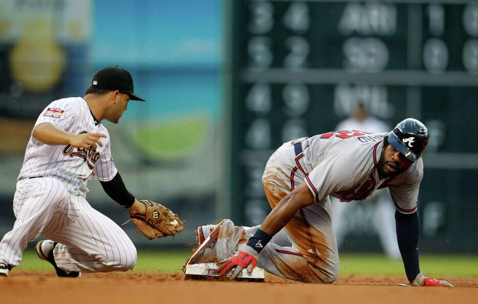 Atlanta Braves right fielder Jason Heyward (22) steals second base from Houston Astros second basema