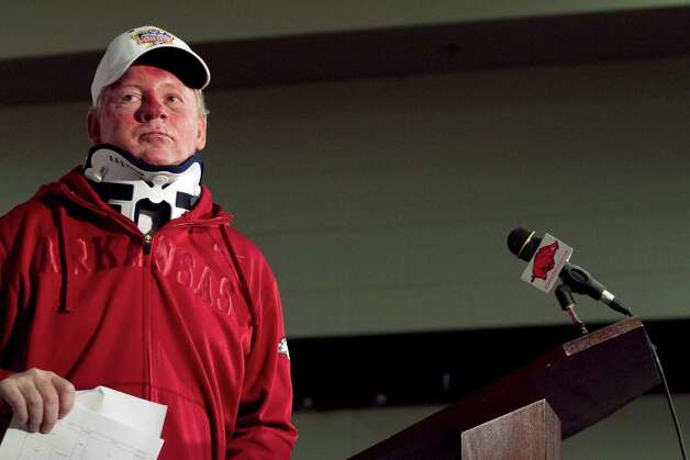 In this Tuesday, April 3, 2012, photo, Arkansas football coach Bobby Petrino speaks during a news conference in Fayetteville, Ark. Petrino has been put on paid leave. Athletic director Jeff Long announced the decision late Thursday, April 5, capping a stunning day in which it was revealed that Petrino had a 25-year-old female employee with him during a weekend motorcycle ride that ended in a crash. (AP Photo/Gareth Patterson) Photo: Gareth Patterson