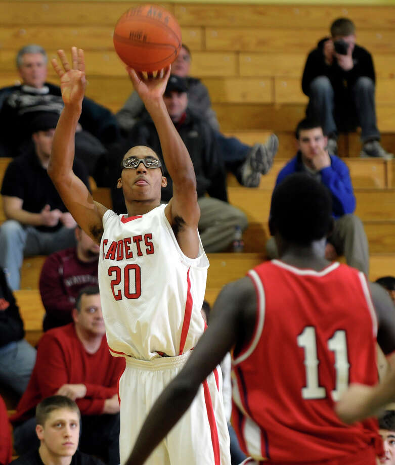 Albany Academy's Jelani Currie (20) put a shot over Schenectady's Eddie Stanley (11) during their basketball game at Siena College in Loudonville,N.Y., Sunday, Jan. 30, 2011. (Hans Pennink / Special to the Times Union) High School Sports Photo: Hans Pennink / 00011902A