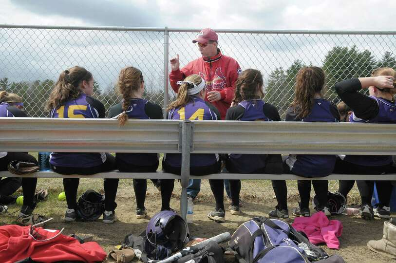Sam Fitzgerald, center, head coach of Ballston Spa High School softball team talks to his players fo
