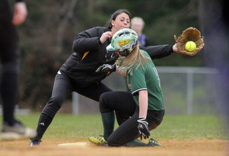 Katy Rimawi of Ballston Spa High School softball team catches a throw to third as a runner slides in safe during their game against Shenendehowa High School on Wednesday, April 11, 2012 in Ballston Spa, NY.     (Paul Buckowski / Times Union) Photo: Paul Buckowski