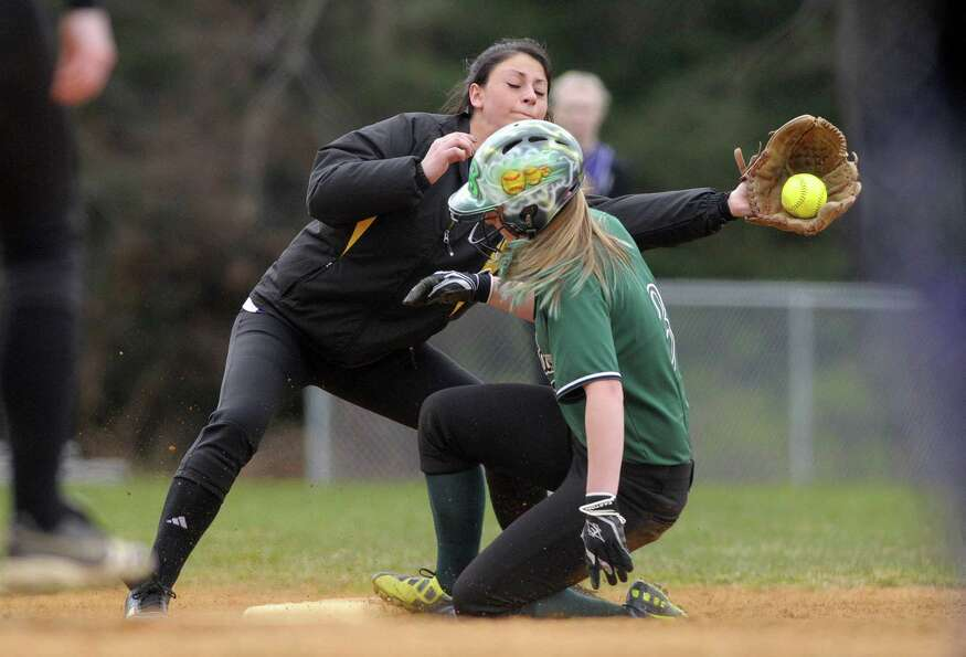 Katy Rimawi of Ballston Spa High School softball team catches a throw to third as a runner slides in