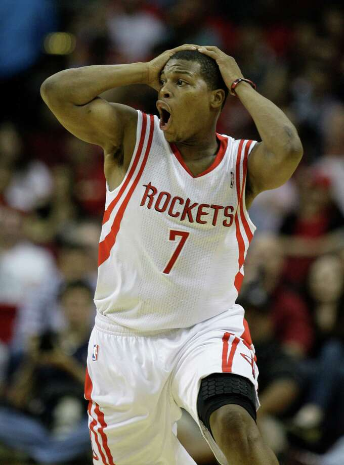Houston Rockets' Kyle Lowry reacts to a call not being made against the  Utah Jazz during the third quarter of NBA game at Toyota Center  Wednesday, April 11, 2012, in Houston. He was asking for a traveling call. Photo: Melissa Phillip, Houston Chronicle / © 2012 Houston Chronicle
