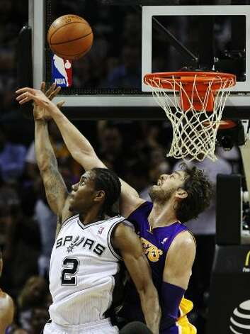 Spurs' Kawhi Leonard (02) attemps a shot against Los Angeles Lakers' Pau Gasol (16) in the first half at the AT&T Center on Wednesday, Apr. 11, 2012. Kin Man Hui/Express-News. (San Antonio Express-News)