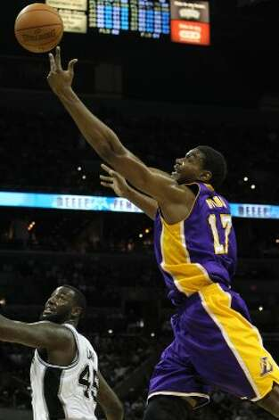 Los Angeles Lakers' Andrew Bynum (17) contends for a rebound with Spurs' DeJuan Blair (45) in the first half at the AT&T Center on Wednesday, Apr. 11, 2012. Kin Man Hui/Express-News. (San Antonio Express-News)
