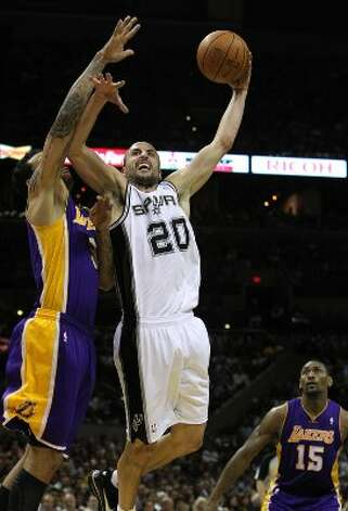 Spurs' Manu Ginobili (20) attempts a shot against Los Angeles Lakers' Devin Ebanks (03) in the second half at the AT&T Center on Wednesday, Apr. 11, 2012. Spurs lose to the Lakers, 84-98. Kin Man Hui/Express-News. (San Antonio Express-News)