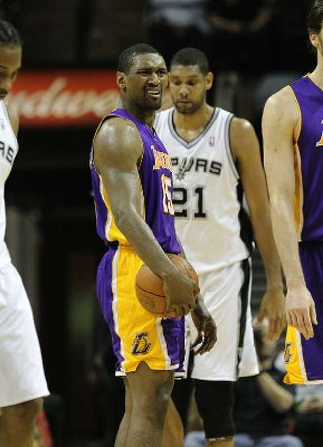 Lakers' Metta World Peace (15) ponders an official's call during their game against the Spurs in the second half at the AT&T Center on Wednesday, Apr. 11, 2012. Spurs lose to the Lakers, 84-98. Kin Man Hui/Express-News. (San Antonio Express-News)