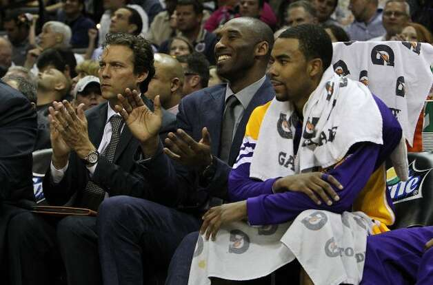 Lakers' Kobe Bryant applauds his team on the floor during their game against the Spurs in the second half at the AT&T Center on Wednesday, Apr. 11, 2012. Bryant did not suit up to play due to a shin injury. Spurs lose to the Lakers, 84-98. Kin Man Hui/Express-News. (San Antonio Express-News)