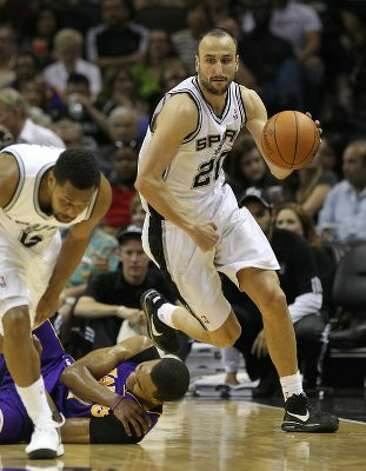 Spurs' Manu Ginobili (20) gets a steal against the Los Angeles Lakers in the second half at the AT&T Center on Wednesday, Apr. 11, 2012. Spurs lose to the Lakers, 84-98. Kin Man Hui/Express-News. (San Antonio Express-News)