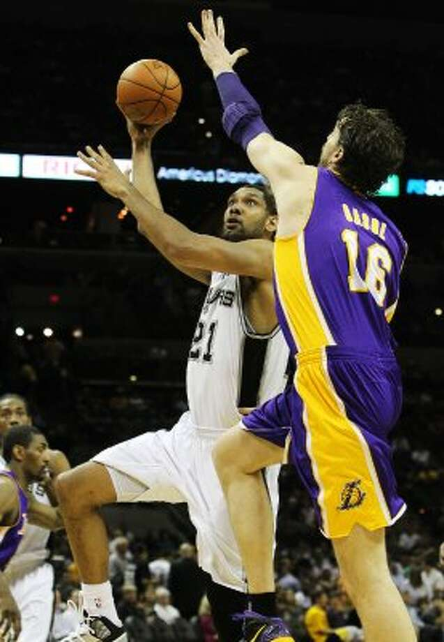 Spurs' Tim Duncan (21) attempts a shot against Los Angeles Lakers' Pau Gasol (16) in the second half at the AT&T Center on Wednesday, Apr. 11, 2012. Spurs lose to the Lakers, 84-98. Kin Man Hui/Express-News. (San Antonio Express-News)