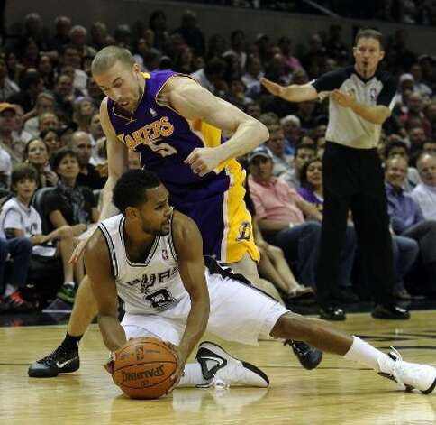 Spurs' Patty Mills (08) gets pressure from Los Angeles Lakers' Steve Blake (05) in the second half at the AT&T Center on Wednesday, Apr. 11, 2012. Spurs lose to the Lakers, 84-98. Kin Man Hui/Express-News. (San Antonio Express-News)