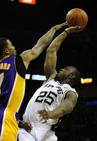 Spurs' James Anderson (25) attempts a shot over Los Angeles Lakers' Ramon Sessions (07) in the second half at the AT&T Center on Wednesday, Apr. 11, 2012. Spurs lose to the Lakers, 84-98. Kin Man Hui/Express-News. (San Antonio Express-News)