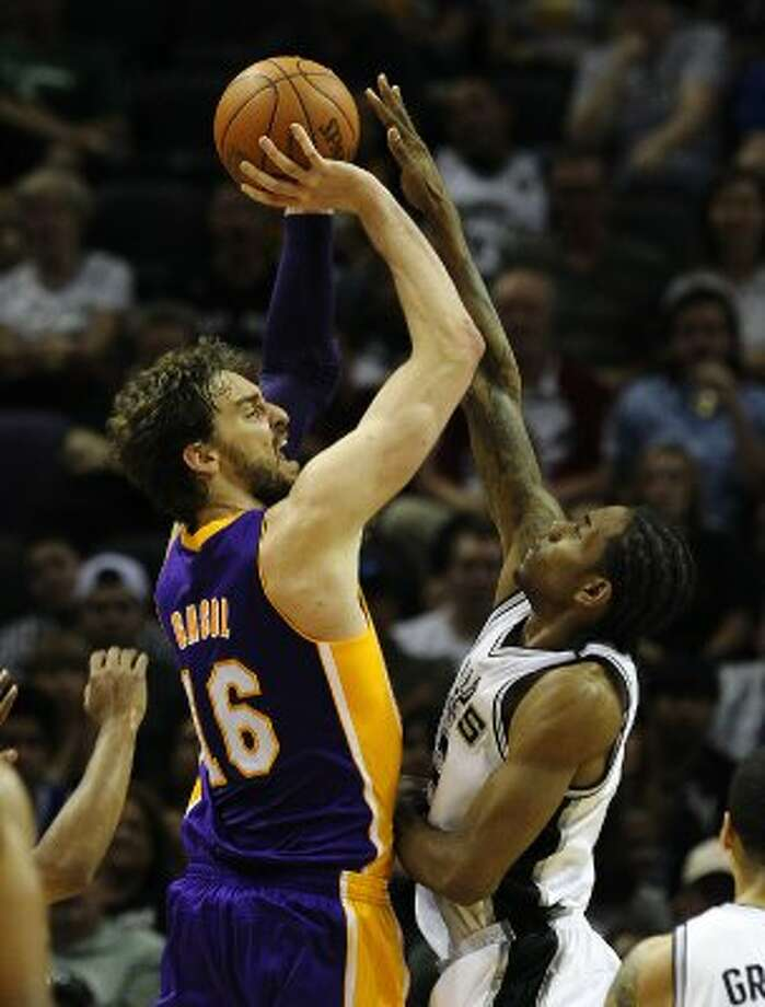 Spurs' Kawhi Leonard (02) defends against Los Angeles Lakers' Pau Gasol (16) in the second half at the AT&T Center on Wednesday, Apr. 11, 2012. Spurs lose to the Lakers, 84-98. Kin Man Hui/Express-News. (San Antonio Express-News)