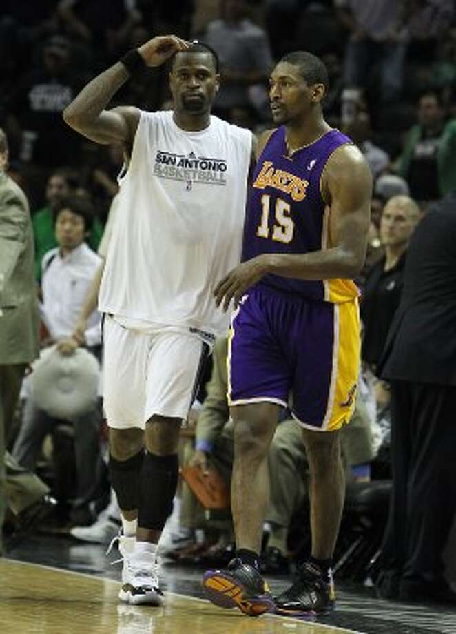 Spurs' Stephen Jackson (03) and Los Angeles Lakers' Metta World Peace (15) meet to chat after their game at the AT&T Center on Wednesday, Apr. 11, 2012. Jackson and World Peace (formerly Ron Artest) played together on the Indiana Pacers in 2004. Spurs lose to the Lakers, 84-98. Kin Man Hui/Express-News. (San Antonio Express-News)