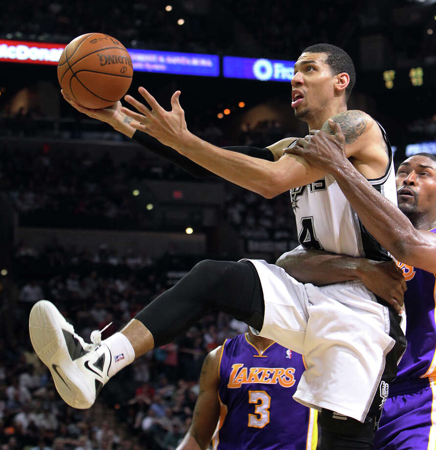 Spurs' Danny Green (04) takes a hard foul by Los Angeles Lakers' Metta World Peace (15) in the second half at the AT&T Center on Wednesday, Apr. 11, 2012. Spurs lose to the Lakers, 84-98. Kin Man Hui/Express-News. Photo: Kin Man Hui, Kin Man Hui/Express-News / ©2012 San Antonio Express-News
