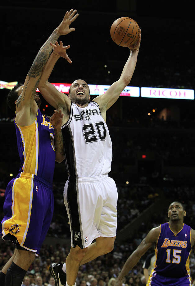 Spurs' Manu Ginobili (20) attempts a shot against Los Angeles Lakers' Devin Ebanks (03) in the second half at the AT&T Center on Wednesday, Apr. 11, 2012. Spurs lose to the Lakers, 84-98. Kin Man Hui/Express-News. Photo: Kin Man Hui, Kin Man Hui/Express-News / ©2012 San Antonio Express-News