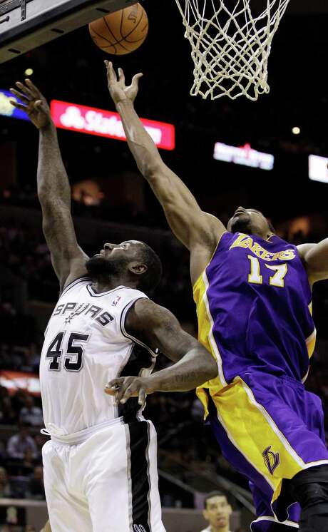 The Lakers' Andrew Bynum (17) reaches over the Spurs' DeJuan Blair for one of his 30 rebounds. Photo: Eric Gay / AP