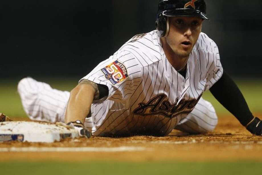 Jordan Schafer dives back to first base during the third inning. (Karen Warren / Houston Chronicle)