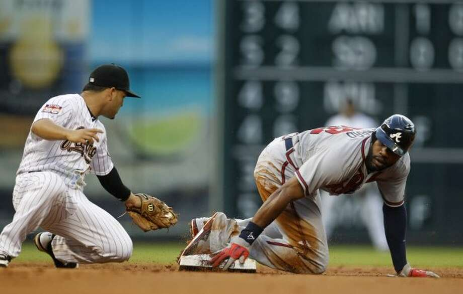 Atlanta's Jason Heyward (22) steals second base from Astros second baseman Jose Altuve (27) during the second inning. (Karen Warren / Houston Chronicle)