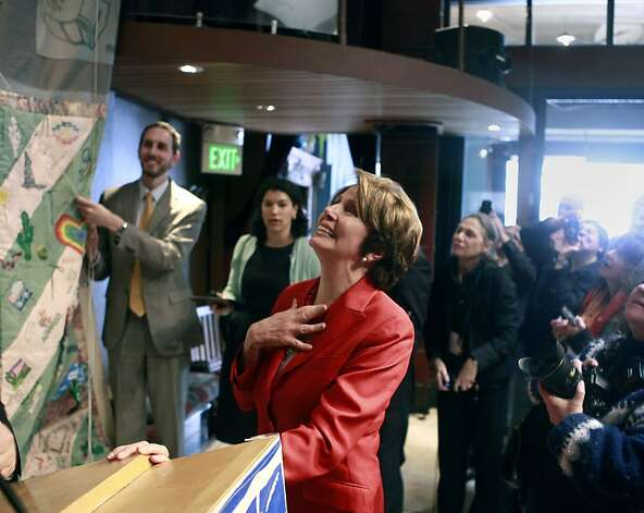 Nancy Pelosi looks up at some of the pieces of the AIDS memorial quilt. Nancy Pelosi appeared at Catch Restaurant to speak about the 25th anniversary of the AIDS memorial quilt on Wednesday, April 11, 2012. Photo: Sean Culligan, The Chronicle