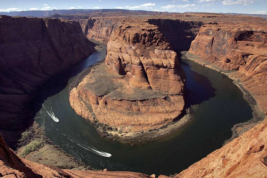 In this Wednesday, March 5, 2008 file photo, water levels at the Colorado River's Horseshoe Bend begin to rise along the beaches just hours after the Glen Canyon Dam jet tubes began releasing water, in Page, Ariz. Drought, climate change and an increasing population in the West are pushing the Colorado River basin toward deep trouble in the coming decades, scientists say. Photo: Matt York, ASSOCIATED PRESS