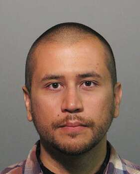 April 11, 2012 – Zimmerman is officially charged with second-degree murder in the death of Trayvon Martin, and he turns himself in to Sanford Police for booking. Photo: Associated Press
