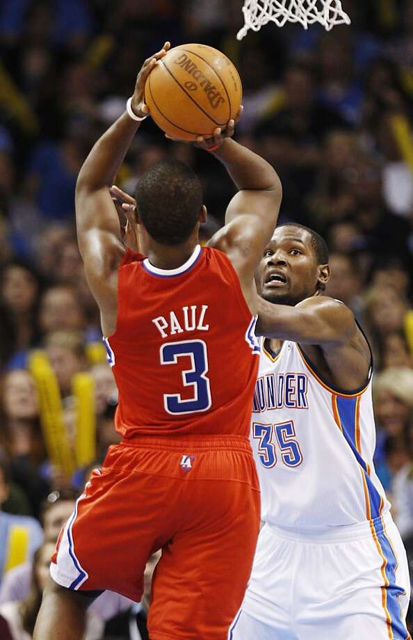 Los Angeles Clippers guard Chris Paul (3) shoots over Oklahoma City Thunder forward Kevin Durant (35) in the fourth quarter of an NBA basketball game in Oklahoma City, Wednesday, April 11, 2012. Los Angeles won 100-98.(AP Photo/Sue Ogrocki) Photo: Sue Ogrocki, Associated Press
