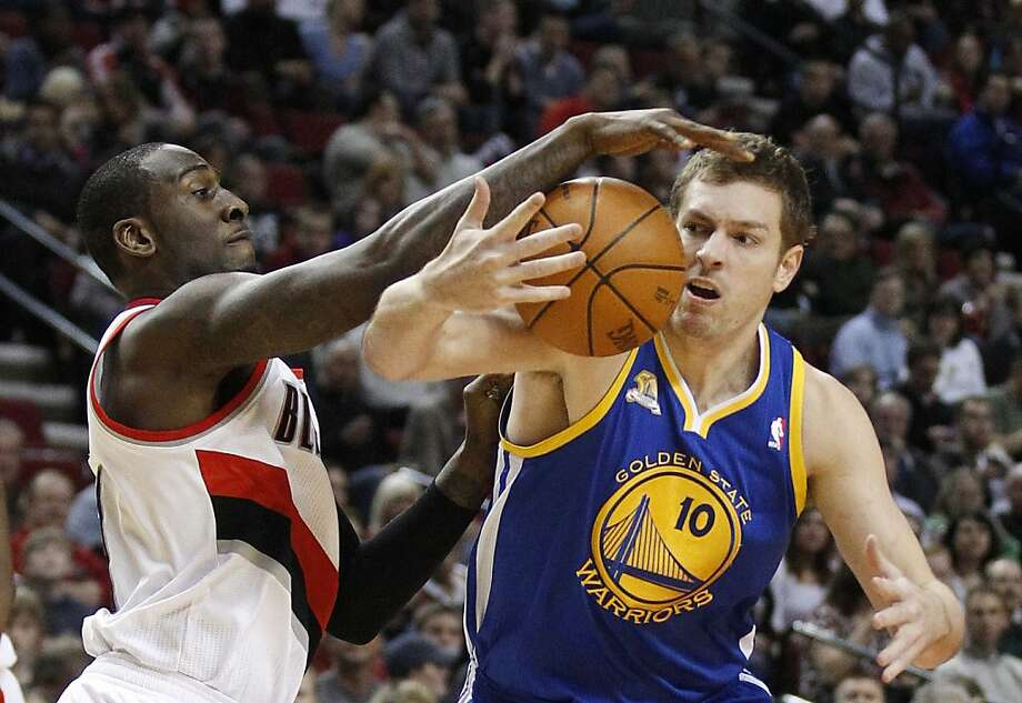 Golden State Warriors' David Lee (10) loses control of the ball as Portland Trail Blazers' J.J. Hickson reaches for it during the first quarter of an NBA basketball game Wednesday, April 11, 2012, in Portland, Ore. Photo: Rick Bowmer, Associated Press