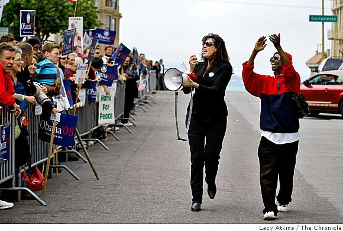 Christine Pelosi, daught of Nancy Pelosi, and Kim Clark lead the crowd of hundreds in a cheer outside the Fairmont Hotel in hopes to see Democratic President candidate Barack Obama, Sunday Aug. 17, 2008, in San Francisco, Calif.