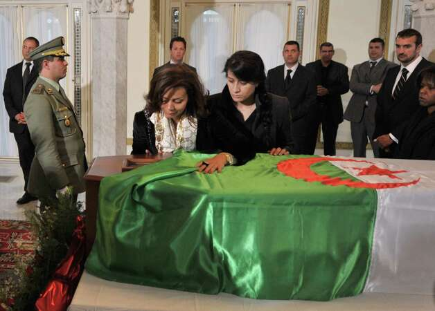 Mahdia ben Bella, second left, pays respect to her father and late Algerian president Ahmed Ben Bella in Algiers, Thursday. Ahmed Ben Bella, Algeria's first president and a historic leader of its bloody independence struggle from France, died at his family home in Algiers on Wednesday. He was 95. Ben Bella, a symbol of pan-Arabist ideology as well as the global anti-colonial movement, was president of Algeria from 1963 until he was overthrown in a military coup in 1965 by the army chief of staff, Col. Houari Boumedienne. Photo: Sidali Djarboub                           , AP / AP