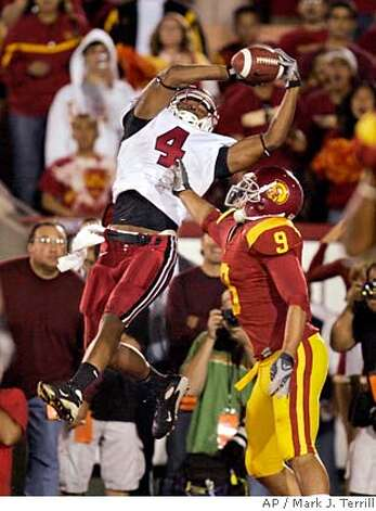 Stanford wide receiver Mark Bradford makes a touchdown catch as Southern California cornerback Mozique McCurtis defends late in the second half of a football game Saturday, Oct. 6, 2007, in Los Angeles. Stanford upset USC 24-23. (AP Photo/Mark J. Terrill) Photo: Mark J. Terrill