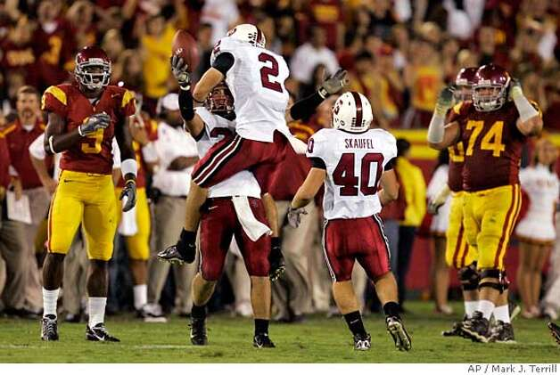 Stanford's Nick Sanchez (2) jumps into the arms of Bo McNally as Southern California's David Ausberry, left, looks on along with Zack Heberer (74) and Stanford's Taylor Skaufel after McNally interceped a pass in the closing seconds of a football game, Saturday, Oct. 6, 2007, in Los Angeles. Stanford upset USC 24-23. (AP Photo/Mark J. Terrill) Photo: Mark J. Terrill